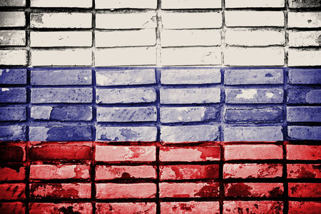 Grunge Russia flag on old brick wall  photo
