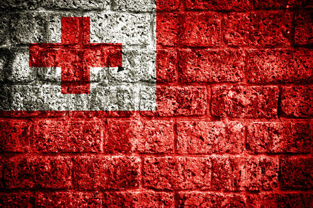 tonga: Flag of Tonga painted onto a grunge brick wall