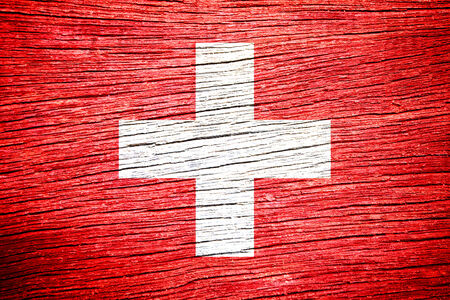switzerland flag on old wood plank texture  photo