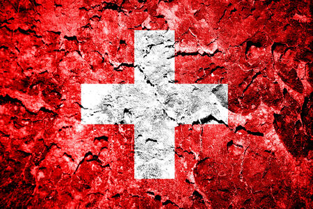 Grunge of European country Switzerland flag on concrete wall  photo