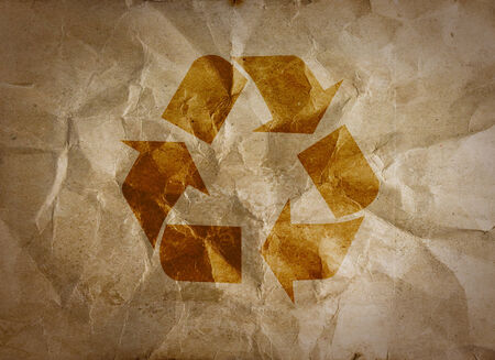 Recycle logo on crumpled paper  photo