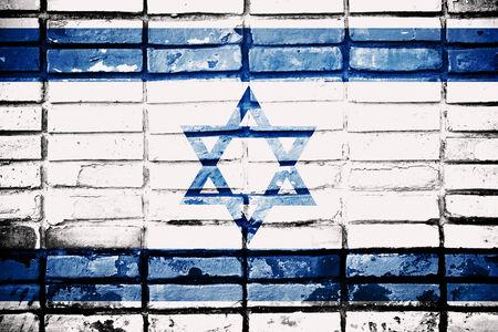 materiales de construccion: Bandera de Israel en la pared de ladrillo Foto de archivo