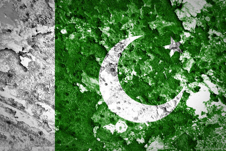 disintegrate: Pakistan Flag painted on concrete wall  Stock Photo