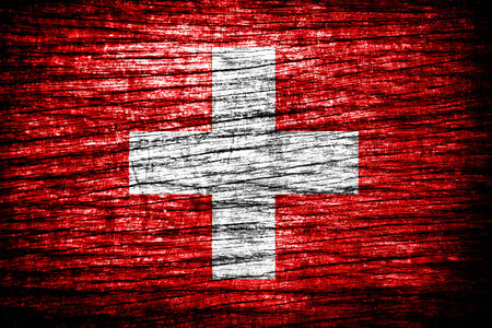 switzerland flag on old wood texture  photo