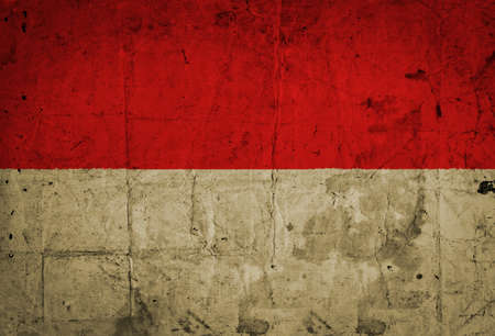 grunge of Indonesia flag on vintage paper  photo