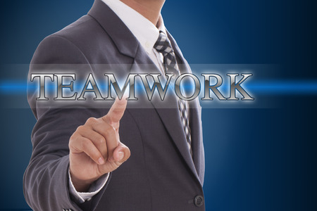 Businessman hand pushing teamwork button on virtual screens  photo