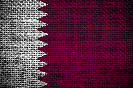 sackcloth: Texture of sackcloth with the image of the Qatar Flag   Stock Photo