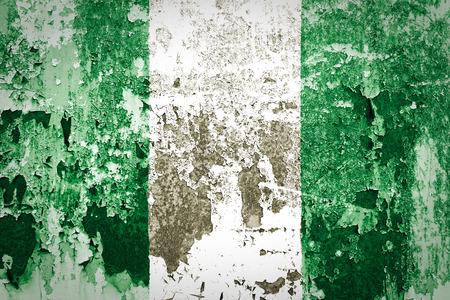 disintegrate: Nigeria Flag painted on grunge wall