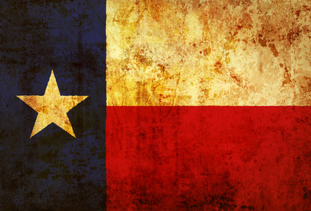 Grunge Texas state Flag on a grunge paper  photo