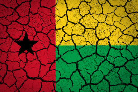 peel off: The Guinea Bissau flag painted on a cracked ground  Stock Photo