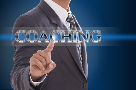 Businessman hand pushing coaching button on virtual screens  photo