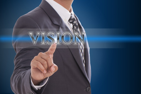Businessman hand pushing vision button on virtual screens  photo