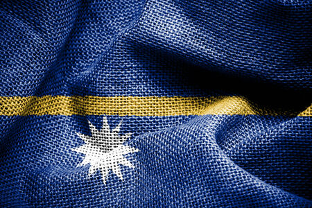 sackcloth: Texture of sackcloth with the image of the Nauru flag