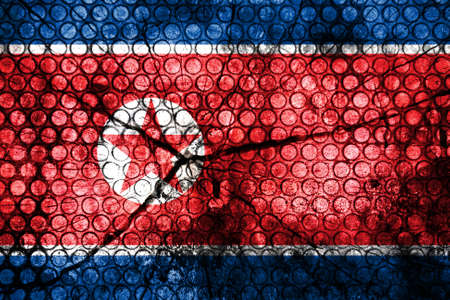North Korea flag on grunge rubber  photo