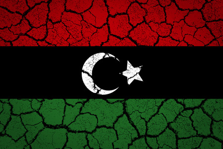 disintegrate: Libya painted on a cracked ground  Stock Photo
