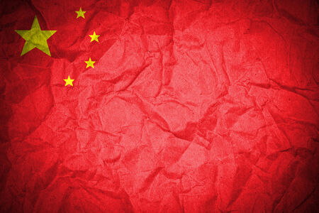 China flag on crumpled paper  photo