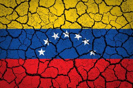 Venezuelan flag painted on cracked ground photo