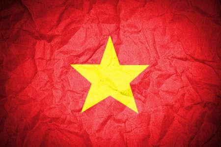 Vietnam flag on crumpled paper  photo