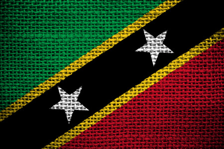 sackcloth: Texture of sackcloth with the image of theof the Saint Kitts and Nevis flag