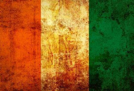 cote d ivoire: Grungy Flag of Ivory coast on vintage paper
