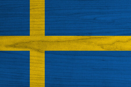 Sweden flag painted on wood background  photo