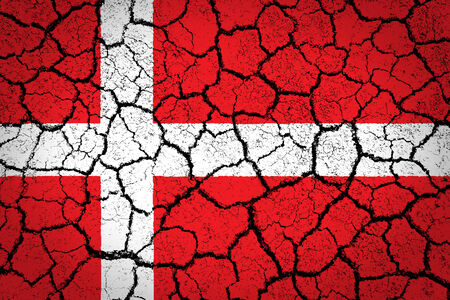 Denmark flag painted on cracked ground  photo