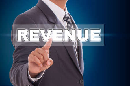 Businessman hand touching revenue on screen  photo