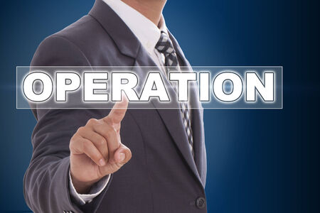 operation: Businessman hand touching operation on screen  Stock Photo