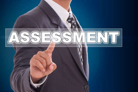 Businessman hand touching assessment on screen  photo