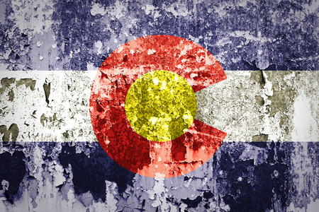 colorado mountains: grunge of Colorado flag on grunge wall