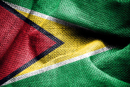 sackcloth: Texture of sackcloth with the image of the Guyana flag