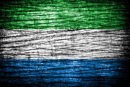 Sierra Leone Flag painted on old wood plank background  photo