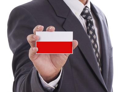 Businessman holding a business card with Poland Flag