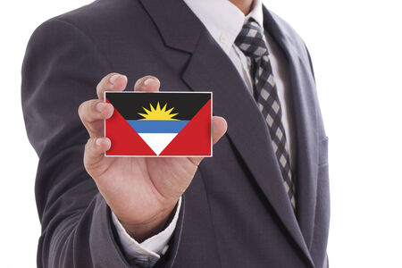 antigua barbuda: Businessman holding a business card with Antigua and Barbuda Flag  Stock Photo