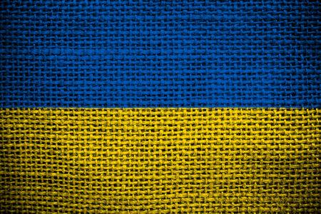 ukrainian flag: Texture of sackcloth with the image of the Ukrainian flag
