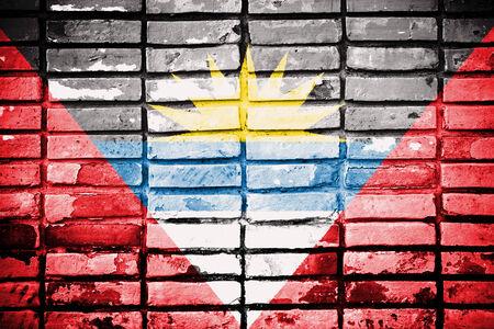 barbuda: Antigua and Barbuda flag on old brick wall  Stock Photo