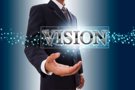 Businessman hand showing vision button on virtual screen   photo