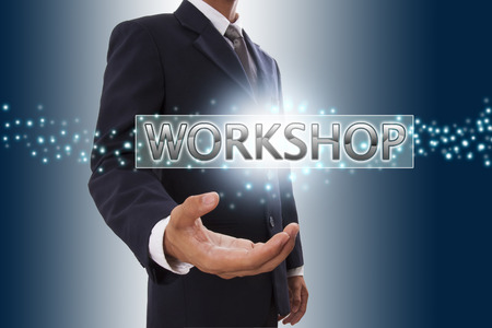 Businessman hand showing workshop button on virtual screen   photo