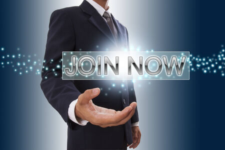 Businessman hand showing join now button on virtual screen   photo