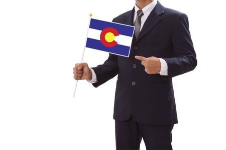 patiotic: Businessman in suit holding of Colorado Flag