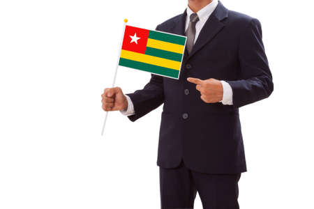 Businessman in suit holding of Togo Flag  photo