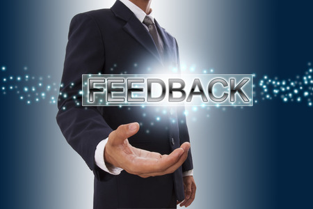 Businessman hand showing feedback button on virtual screen  photo