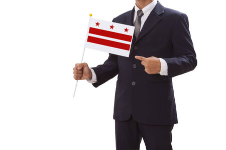 district of columbia: Businessman in suit holding of the Washington DC Flag Stock Photo