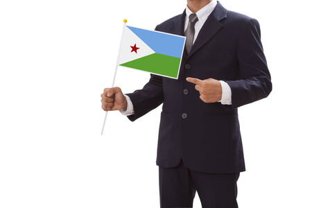 Businessman in suit holding of the Djibouti Flag