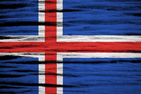 flag of iceland: Bandera de Islandia sobre la textura de madera vieja Foto de archivo