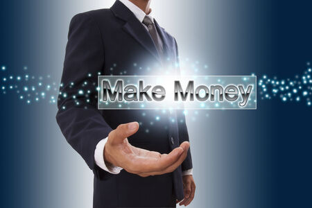 Businessman hand showing make money button on virtual screen   photo