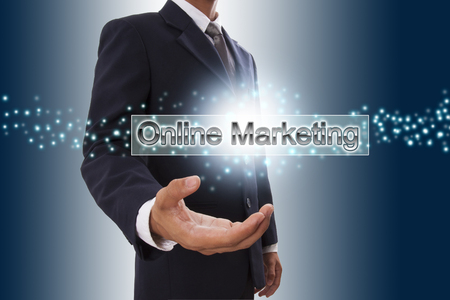Businessman hand showing online marketing button on virtual screen   photo