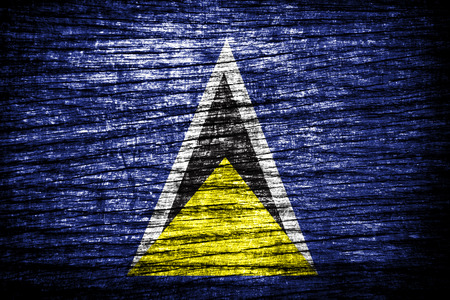 saint lucia: Saint Lucia flag on wood texture  Stock Photo