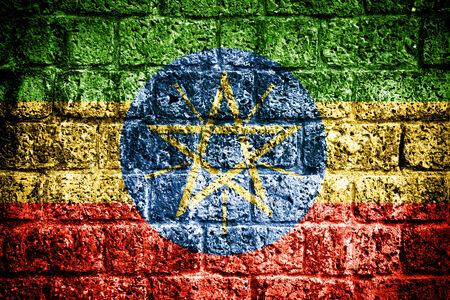Ethiopia Flag painted on old brick wall  photo
