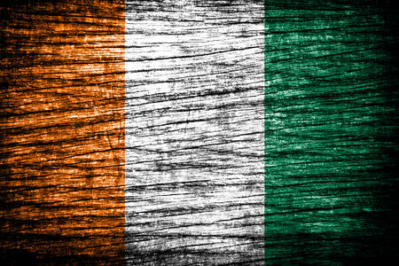 cote d ivoire: Ivory Coast Flag on old wood texture  Stock Photo